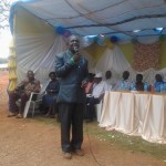 A representative parent delivering a speech