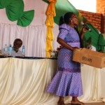 Hanga village mayor holding a box leading the congregation for donations for the school